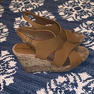Tan cork bottom strappy wedges